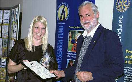 Danielle Lees recieving a plaque for her presentation from Russell Higgenbotham.