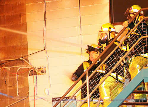 Firefighters battle the blaze at the Coffs Harbour Sign It Up factory in2010, which police allege was deliberately lit as part of an insurance scam.