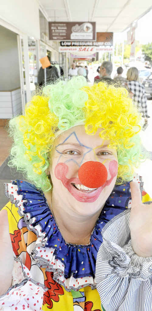 Kellee Marscham of ESP clowns will be around Prince Street on Crazy Day.