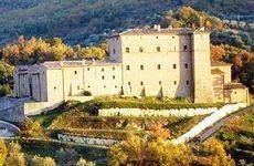 Castello di Potentino looms in the hills of Tuscany.