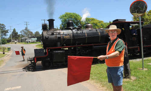 Flagmen Brian Davis and Geoff Johanson will man the level crossing at Dagun Station for the final time on November 21, marking the end of an historic tradition.