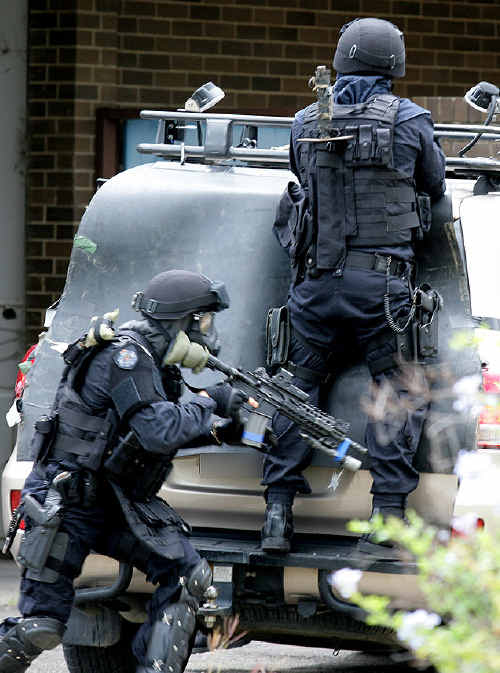 Queensland Police Special Emergency Response Team responds to a simulated small arms attack as part of Exercise Koala Amber at RAAF Base Amberley.