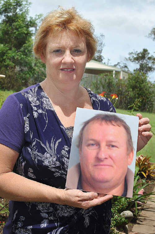 MOURNING: Kim Joynson holds a photo of her late husband Willie at her Tinana home yesterday.