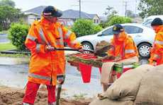SES volunteers Aaron Compton, Dale Kimball and Tabitha Gibson had to fill over 300 sandbags to help flood victims in the Bundaberg region.