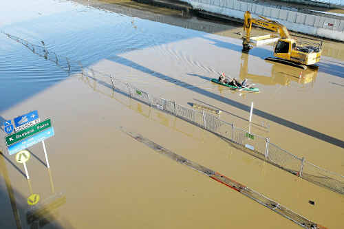 The flooded Ipswich Motorway at Goodna on Thursday became a causeway.