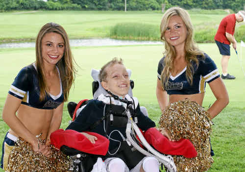 SPORTS FAN: Alex Malarkey with cheerleaders from the St Louis Rams, one of his favourite teams.