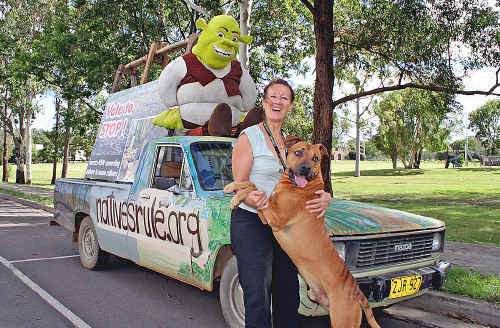 Frances Pike with The Golden Pup (aka her dog Buster) and her ute.