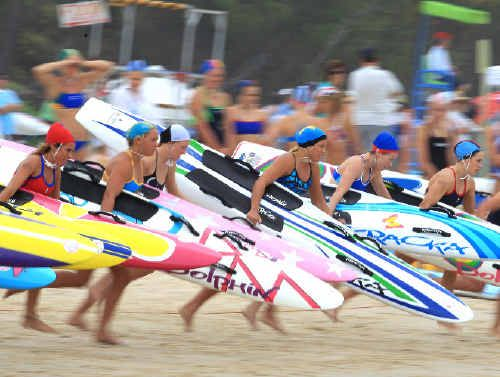 Under-17 girls racing for Kingscliff's waters.