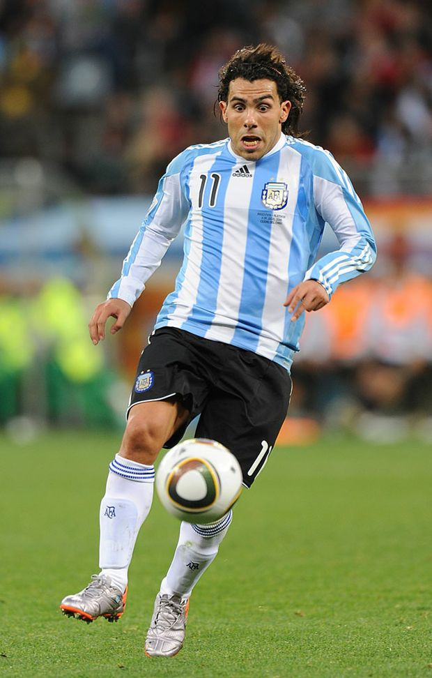 Carlos Tevez, seen here playing for Argentina, is tipped to score the winning goal when Manchester City clash with Manchester United in the Premier League on Monday night.