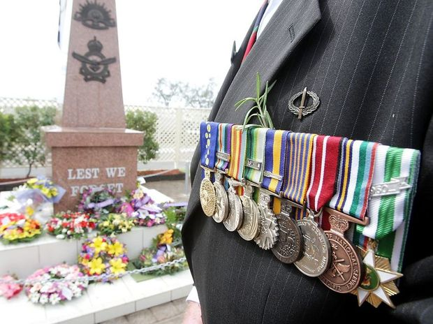 A serviceman displays his medals on Anzac Day last year.