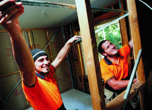 Carpentry Apprentices Ben Payne (left) and Stone Crothers, of Apprenticeships Queensland, are participating in the Bundamba Flood Recovery program.