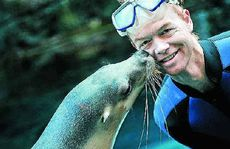 Teiko kicks up her flippers as she celebrates her birthday with a peck on the cheek for Brendan Nolan.