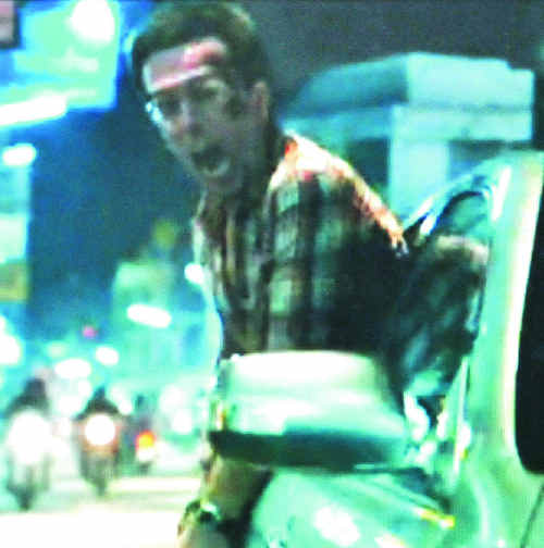 A still from the movie trailer for The Hangover Part II shows injured stuntman Scott McLean with his head sticking out of a moving car. Just seconds later he was badly injured.
