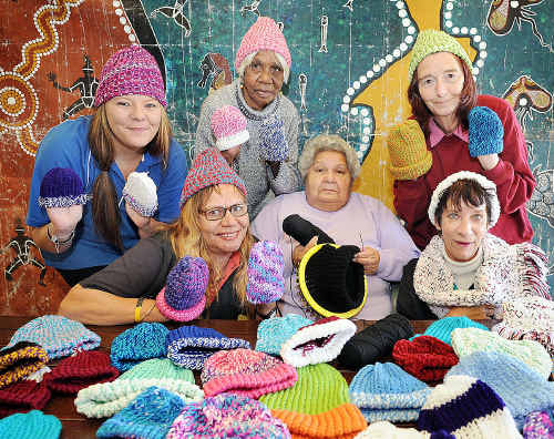 Knitting beanies for hospital patients are (front, from left) Del Howden, Pauline Briggs, Judy McConnell, (back, from left) Kylie Beard, Helen Slater and Carol Russell.