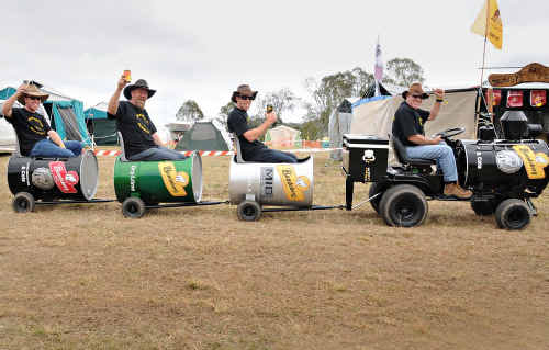 On the Black Rattler, a clever invention doing the rounds at this year's Optus Music Muster, are (right to left) Al Willcox, Justin Willcox, Dave Payne and Ben Willcox. The Black Rattler may not reach the pace of its Valley Rattler cousin, but the inventors say at a walking speed, it's great for enjoying a drink or two.
