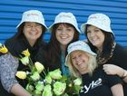 The Chronicle staff members (from left) Maxine Roberton, Tennielle Copson, Tracey Gyde and Laura Tuffield model the floral hats which could win you a trip to the Gold Coast.