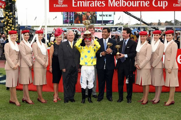 Emirates Melbourne Cup-winning jockey Lemaire celebrates with connections of Dunaden. Also pictured, left, is Richard Vaughan Emirates' DSVP commercial operations worldwide.