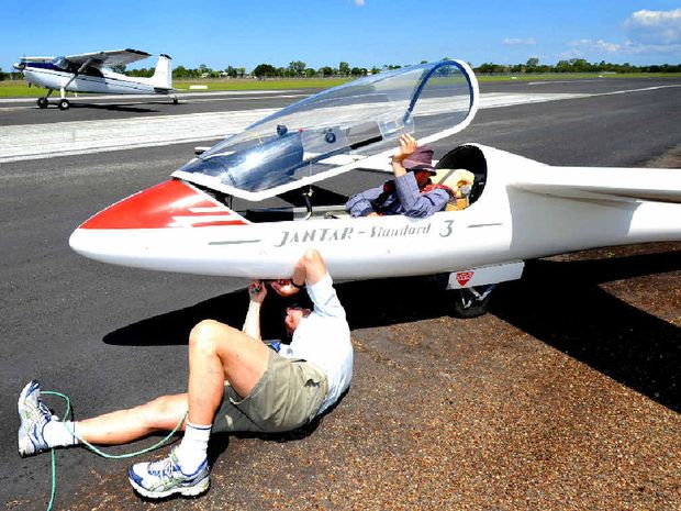 Ground staff prepare a glider for take off during the recent come-and-try-gliding day at Maryborough Aerodrome in 2011.