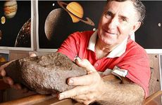 Astronomer Owen Bennedick with pieces of asteroid collected from around the world.