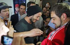 David Beckham was mobbed when he touched down at Melbourne's Tullamarine Airport.