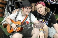 Jenna Gray and Jimmy James sing a tune at Woodford Folk Festival.