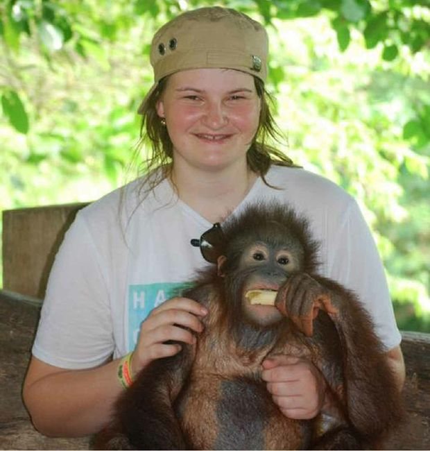 High school graduate Tegan Clarke in Bali with an orangutan. She says that it's tourists who give the country a bad name.