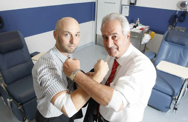 RW Ramsey and Co. partner Paul Saba and Bendigo Bank regional manager Michael List compete to give the most blood.