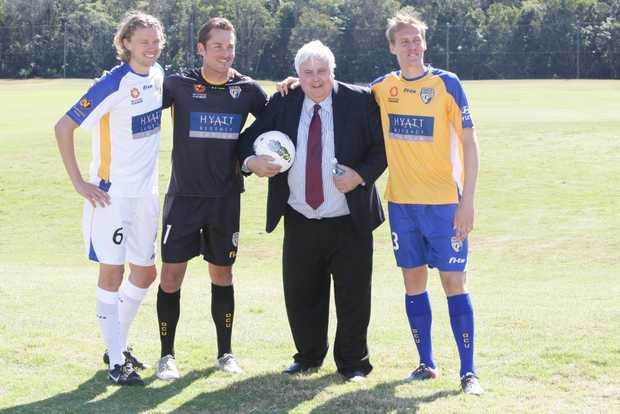 Clive Palmer -Mining magnate, property developer, owner of Hyatt Regancy Coolum and Gold Coast United with GCU's players, (R-L) Paul Beekmans, Glen Moss and Captain Michael Thwaite in their teams new playing strip. Photo: Kari Bourne / Sunshine Coast Daily