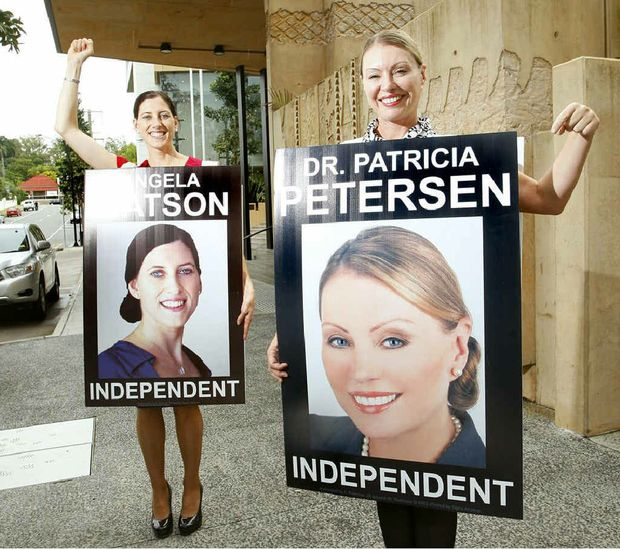 Independent candidates Angela Watson and Patricia Petersen appeared in Ipswich Courthouse wearing billboard signs in protest over council fines relating to electoral signs.