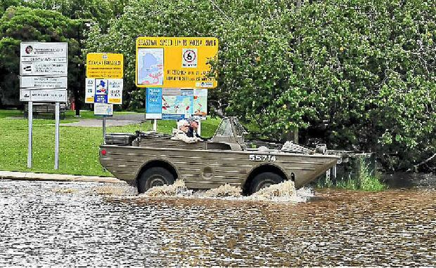 John Summers, 76, and wife Naomi head into the Noosa River for the Boathouse floating restaurant in their vintage amphibious military vehicle.