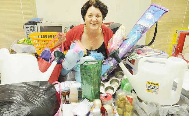 Martine Britton with some of the items that will be available at the Show Society's Garage Sale.