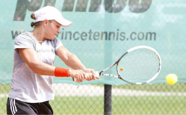 Ipswich tennis star Ashleigh Barty warms up at Leichhardt yesterday in readiness for her first match today.