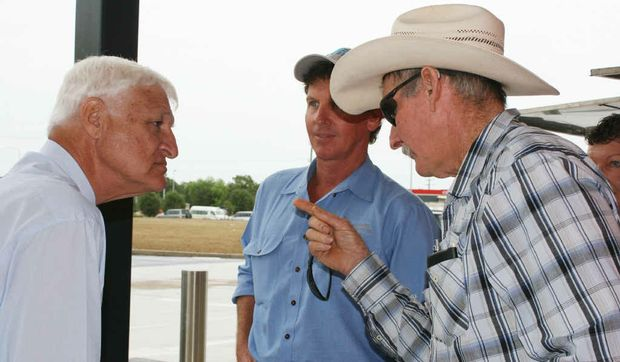 CAMPAIGN TRAIL: Katter's Australian Party leader Bob Katter listens to concerns of Central Highlands farmers Paul Murphy and Mick Shaw, who put the hard word on the maverick politician. Photo: Tara Miko EME200312katter44