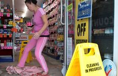 WHAT A MESS: Pharmacy assistant Kazz Cerezo cleans the Discount Chemist at Alexandra Headland.