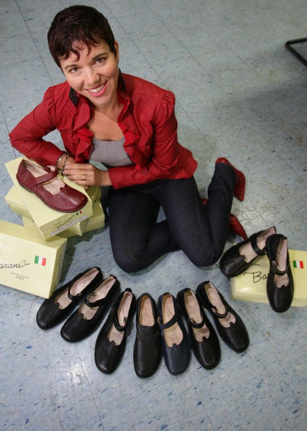 Kathryn Lawrence with the womens shoes she designed.