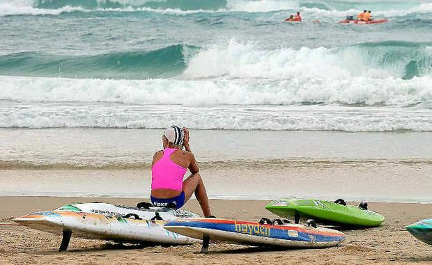 An under-15s competitor from the Maroochydore club looks out to sea before competing at the Australian Surf Life Saving Championships at North Kirra.