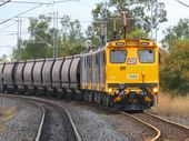 A CENTRAL Queensland coal train driver is suing railway company Aurizon for more than $750,000 in damages after the seat he was sitting in slid off its runners.