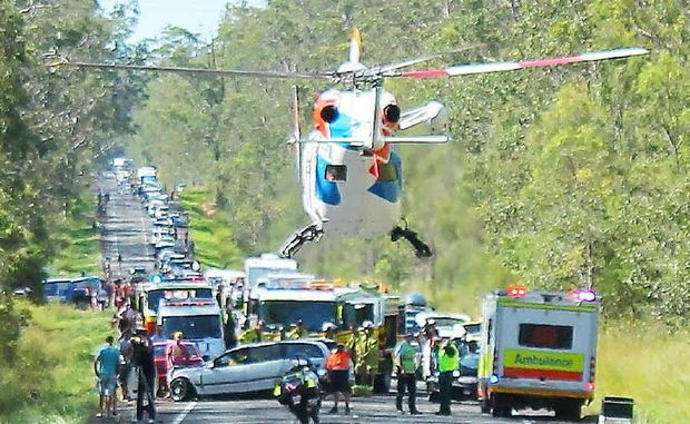 The 18-year-old driver of a Commodore remains in hospital after a four-car crash on Monday. None of the 12 people involved lost their lives.