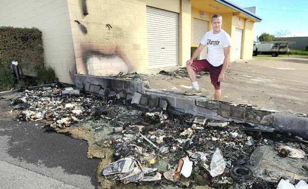 Menus on Main owner Ben Hosking surveys damage caused by wheelie bin fires behind Main St.