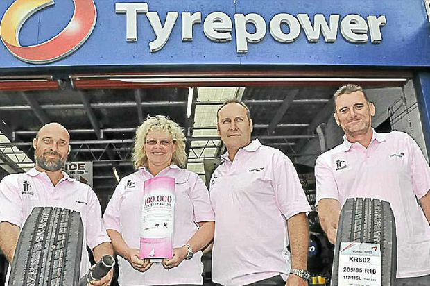 Justin Air, Allison Flanders, Dallas Flanders and Chris White of Tyrepower Noosaville support Kumho Tyres Pink Fitters Day.