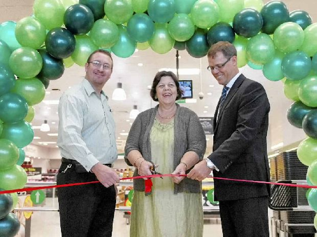 Centre manager Chris Davies, Mayor Gail Sellers and Paul Oates, head of Woolworths Property, cut the ribbon at the entry of the new store.