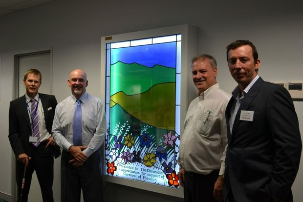 PRESENTATION: Admiring a stain glass window refurbished by builders FK Gardner and Sons and presented to The Chronicle are (from left)  Chronicle general manager Rohan Gosstray,  editor-in-chief Steve Etwell, Gary Gardner and Darryl Green.
