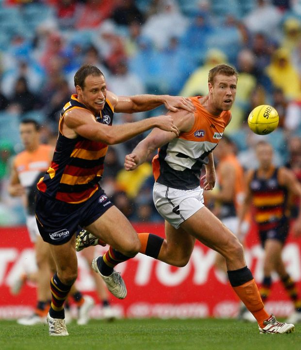 Ben Rutten of Adelaide Crows challenges Jonathan Giles of Greater Western Sydney Giants during round four of the AFL match at AAMI Stadium