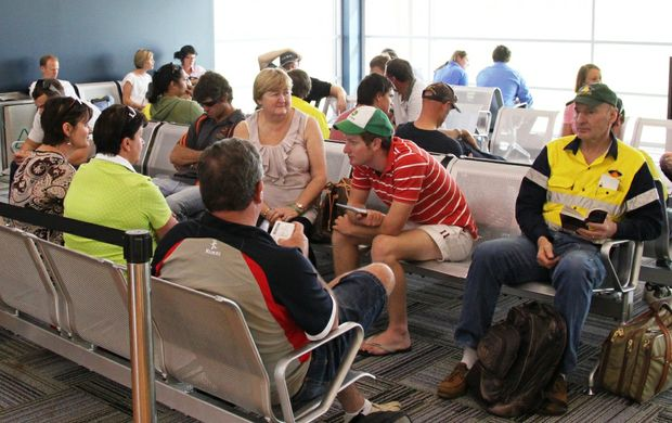 Crowds wait in the new departures lounge at the AT Berry airport terminal.