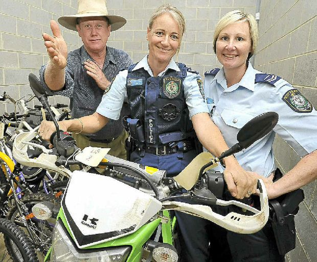 Auctioneer Kevin Cocciola from Ian Weir and Sons and Senior Constables Tracie Lyons and Megan Cook with some for the Richmond Local Area Command Police Auction next Friday.