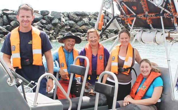 TERRIFIC EXPERIENCE: ACV Ocean Protector senior customs officer Euan Weate with Sailability Whitsundays and Compass participants and volunteers Al McCarragher, Jenny Stratford, Lara Foster and Sigrid Eitler on Tuesday. Photo Aimee Vinci / Whitsunday Times