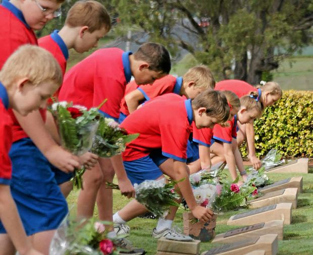 Students from Freestone State School laying posies at the War Graves.