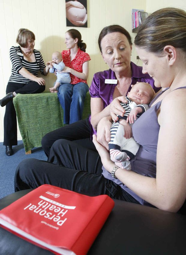 My Midwives Ipswich midwife Teresa Walsh checks over Anna Colquhoun's three-week-old baby Leo (front) with midwife Hazel Mastin catching up with Emma Robinson and her four-month-old Henry Teakle (back).