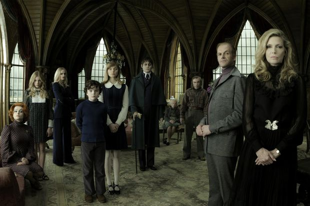 The cast of the movie Dark Shadows, from left, Helena Bonham Carter, Chloe Grace Moretz, Eva Green, Gulliver McGrath, Bella Heathcote, Johnny Depp, Ray Shirley, Jackie Earle Haley, Jonny Lee Miller and Michelle Pfeiffer.