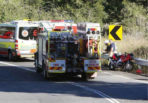 Emergency services crews at the crash scene. Photo: Sarah Harvey